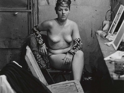 Diane-Arbus-11.-Stripper-with-bare-breasts-sitting-in-her-dressing-room-Atlantic-City-N.J.-1961